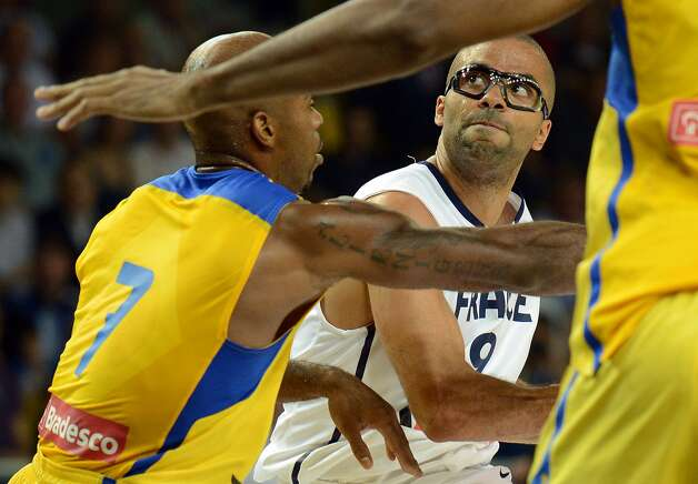 France's player Tony Parker, right, vies with Brazil's player Larry Taylor, during the basketball match France vs Brazil, in Strasbourg, eastern France, on July 21, 2012 as part of the preparation for the London 2012 Olympics. (Patrick Hertzog / AFP/Getty Images)