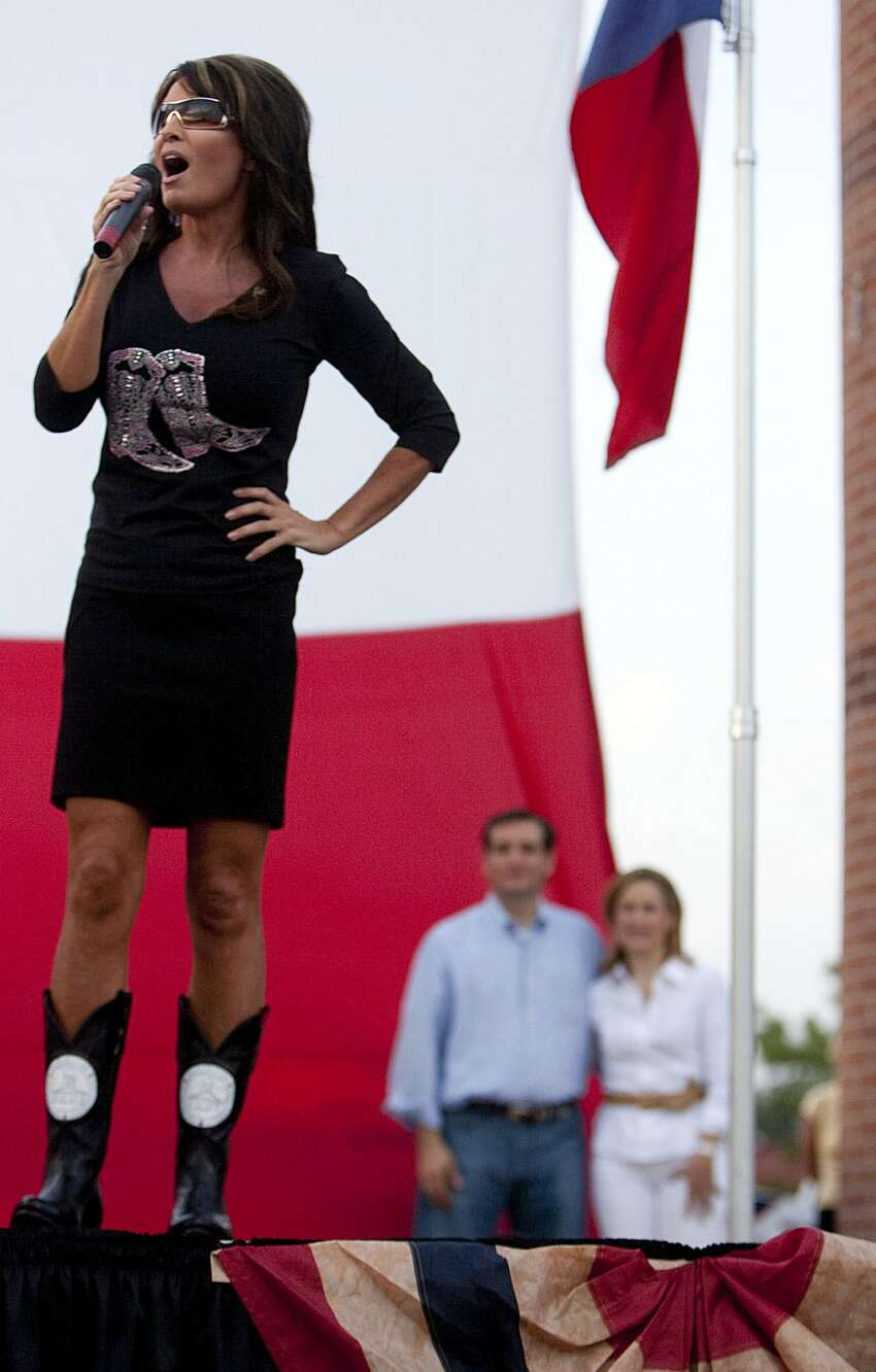 Sarah Palin speaks to a crowd of about 1,000 Ted Cruz supporters she rallied for Cruz, a Texas candidate for the U.S. Senate, who was watching with his wife Heidi Friday, July 27, 2012, at Town Green Park in The Woodlands. South Carolina Sen. Jim DeMint also spoke at the rally. Ted Cruz is running against Lt. Gov. David Dewhurst in a runoff election next week. ( Johnny Hanson / Houston Chronicle ) (Houston Chronicle)