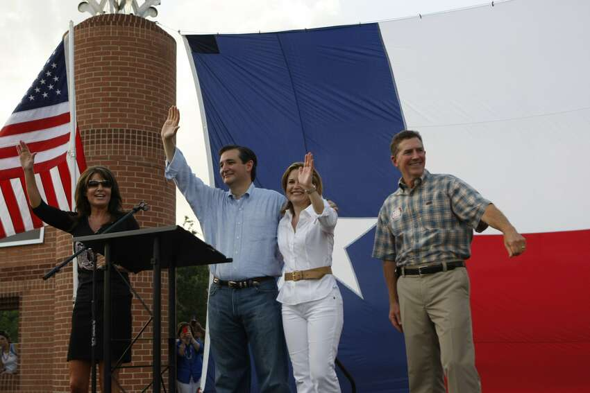 Former Governor of Alaska Sarah Palin, left, and South Carolina Gov. Jim DeMint, right stand with Ted Cruz, Texas candidate for the U.S. Senate, and his wife Heidi during a rally Friday, July 27, 2012, at Town Green Park in The Woodlands. South Carolina Sen. Jim DeMint also spoke at the rally. Ted Cruz is running against Lt. Gov. David Dewhurst in a runoff election next week. ( Johnny Hanson / Houston Chronicle ) (Houston Chronicle)
