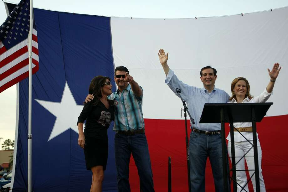 Next to former Governor of Alaska Sarah Palin stands with her husband Todd and Ted Cruz, Texas candidate for the U.S. Senate, and his wife Heidi Friday, July 27, 2012, at Town Green Park in The Woodlands.  South Carolina Sen. Jim DeMint also spoke at the rally. Ted Cruz is running against Lt. Gov. David Dewhurst in a runoff election next week. ( Johnny Hanson / Houston Chronicle ) (Houston Chronicle)
