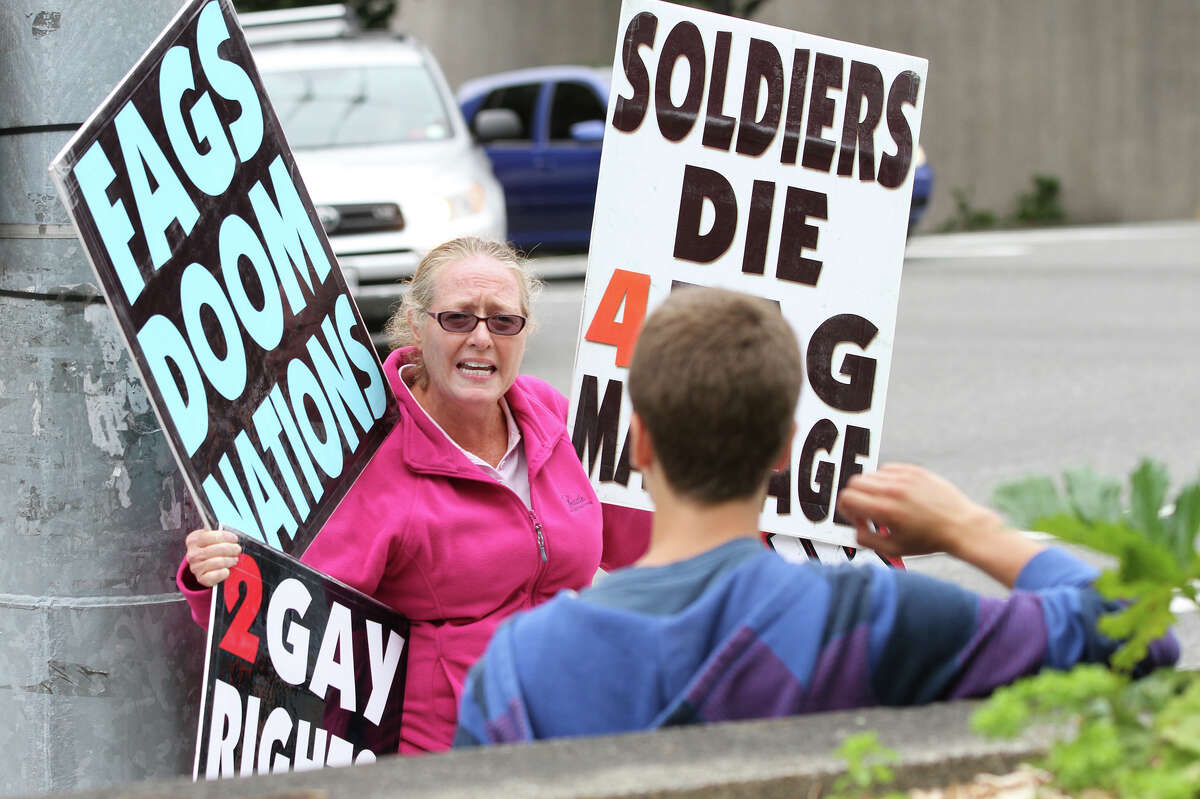Westboro Baptist Church member Margie Phelps debates with protester Liam Kinkead.