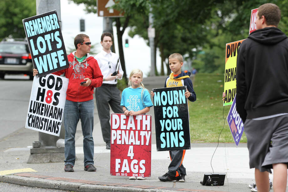 Members of Westboro Baptist Church gather on the corner of Northeast 45th Street and 15th Avenue Northeast. Photo: Joshua Bessex / The Daily of the University of Washington
