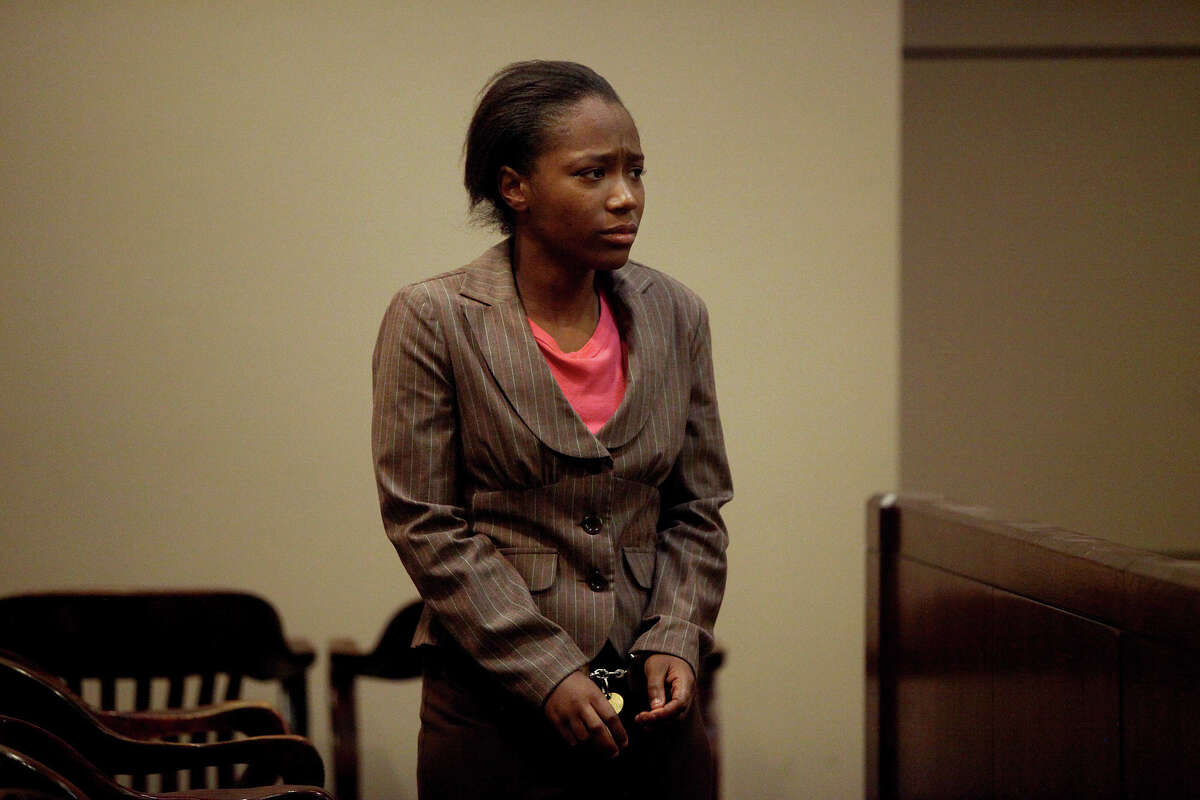 After receiving her sentence of nine years in prison and being handcuffed, Tiffany James walks to the jury box to stand for La Tonya Ranson-Archer, the Godmother of Antwan Wolford, to give a Victim Impact Statement at the conclusion of James' trial for the death of Wolford in the Bexar County 399th District Court on Friday, July 27, 2012. James was found guilty of manslaughter Thursday night.