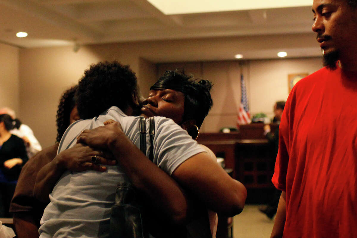 Eashonne Wolford, center, the mother of Antwan Wolford, is embraced by his Godmother, La Tonya Ranson-Archer, while Eashonne's husband, Dawayne Huggins, right, watches after Tiffany James was sentenced to nine years in prison for the death of Wolford at the conclusion of the trial in the Bexar County 399th District Court on Friday, July 27, 2012. James was found guilty of manslaughter Thursday night.