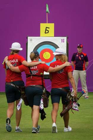 The US Archery team of Jennifer Nichols, Miranda Leek and Khatuna Lorig walk arm in arm toward the targets during the women's archery ranking round at the 2012 London Olympics on Friday, July 27, 2012. Photo: Smiley N. Pool, Houston Chronicle / © 2012  Houston Chronicle