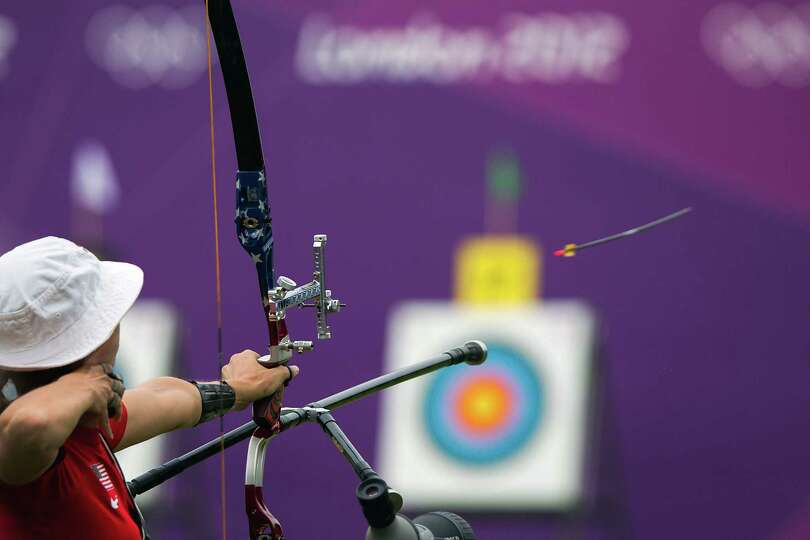 USA's Jennifer Nichols fires an arrow toward the target during the women's archery ranking round at