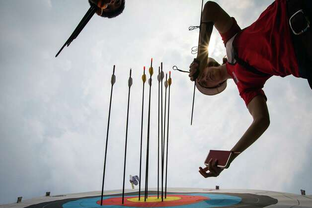 USA's Jennifer Nichols retrieves her arrows after a round of shooting during the women's archery ranking round at the 2012 London Olympics on Friday, July 27, 2012. Photo: Smiley N. Pool, Houston Chronicle / © 2012  Houston Chronicle