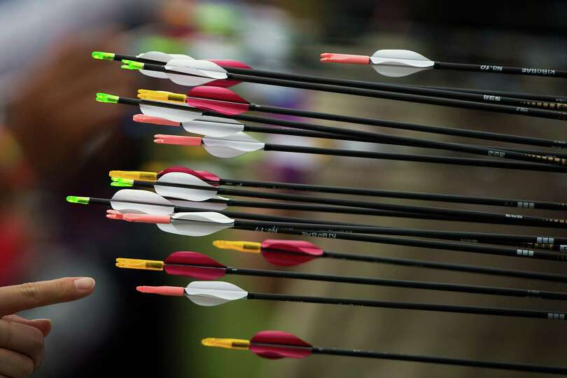 Archers score their arrows during the women's archery ranking round at the 2012 London Olympics on F
