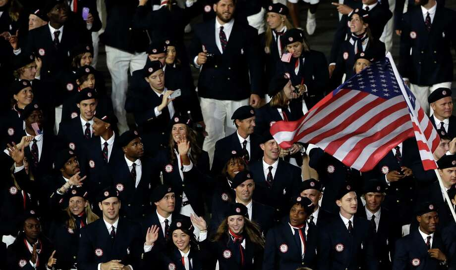 The United States team parade during the Opening Ceremony at the 2012 Summer Olympics, Friday, July 27, 2012, in London. (AP Photo/Paul Sancya) Photo: Paul Sancya
