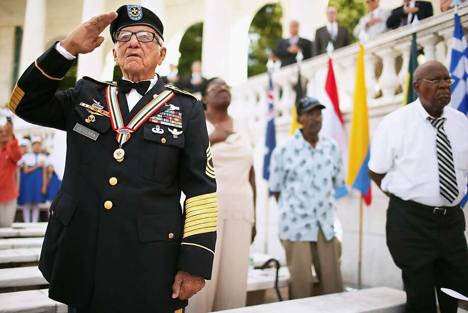 ARLINGTON, VA - JULY 27:  U.S. Army veteran Andres Vergara, 90, of Clearwater, Florida, salutes during the commemoration of the 59th anniversary of the Korean War Armistice at Arlington National Cemetery July 27, 2012 in Arlington, Virginia. With four official combat jumps, paratrooper Vergara recieved the South Korean medal of honor for rescuing 100 children from an orphanage during the war.  (Photo by Chip Somodevilla/Getty Images) Photo: Chip Somodevilla, Getty Images
