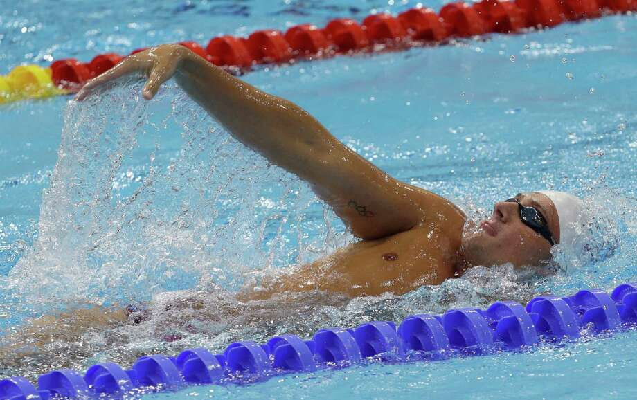 USA's Ryan Lochte swims during a practice session at the Aquatics Center at the Olympic Park ahead of the 2012 Summer Olympics, Wednesday, July 25, 2012, in London. Opening ceremonies for the 2012 London Olympics will be held Friday, July 27. (AP Photo/Lee Jin-man) Photo: Lee Jin-man