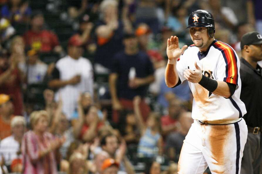 Astros third baseman Chris Johnson celebrates as he heads to home plate. (Eric Kayne / Associated Pr