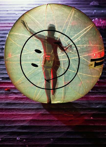 A performer runs through the stadium in a sphere during the opening ceremony for the 2012 London Oly