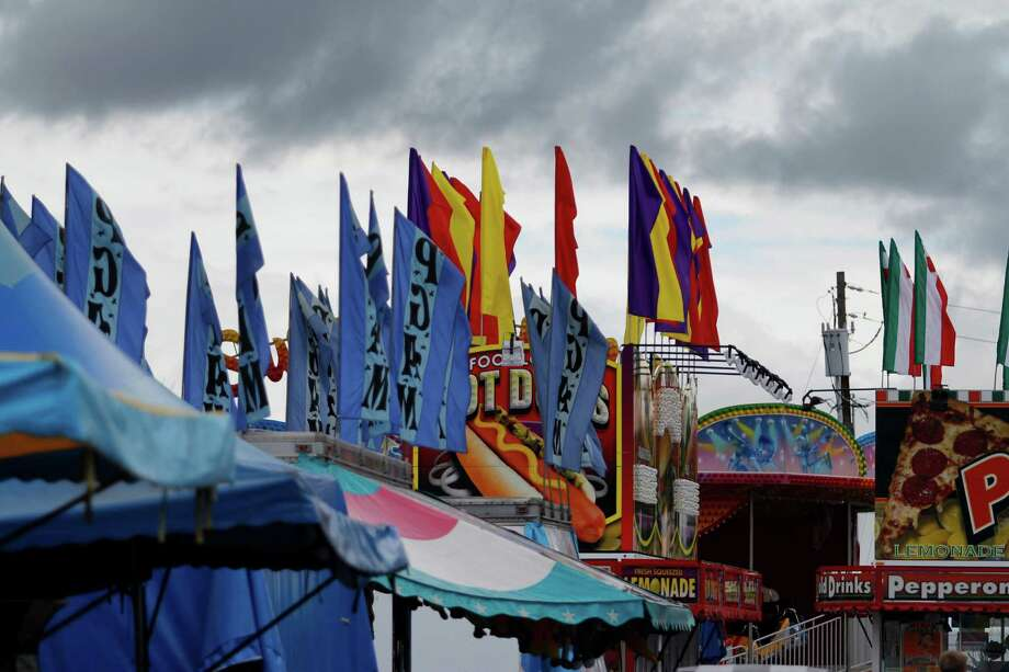 Flags are raised for the carnival attractions as vendors prepare for opening day at the Schoharie County Fair, Friday July 27, 2012 in Cobleskill, N.Y. (Dan Little/Special to the Times Union) Photo: Dan Little / Dan Little