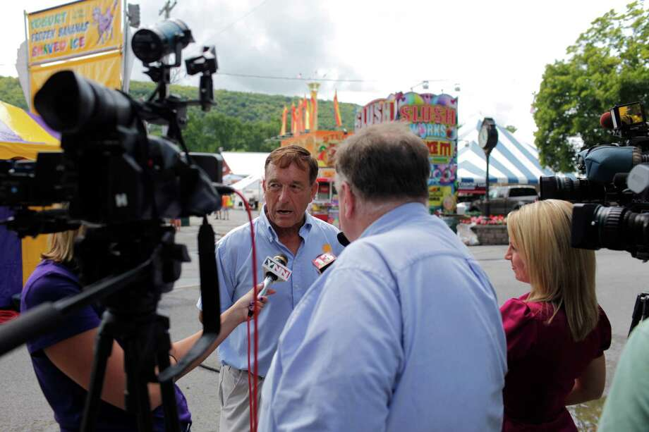 Scoharie County Fair President Douglas Cater is interviewed by local media for opening day at the Schoharie County Fair, Friday July 27, 2012 in Cobleskill, N.Y. (Dan Little/Special to the Times Union) Photo: Dan Little / Dan Little