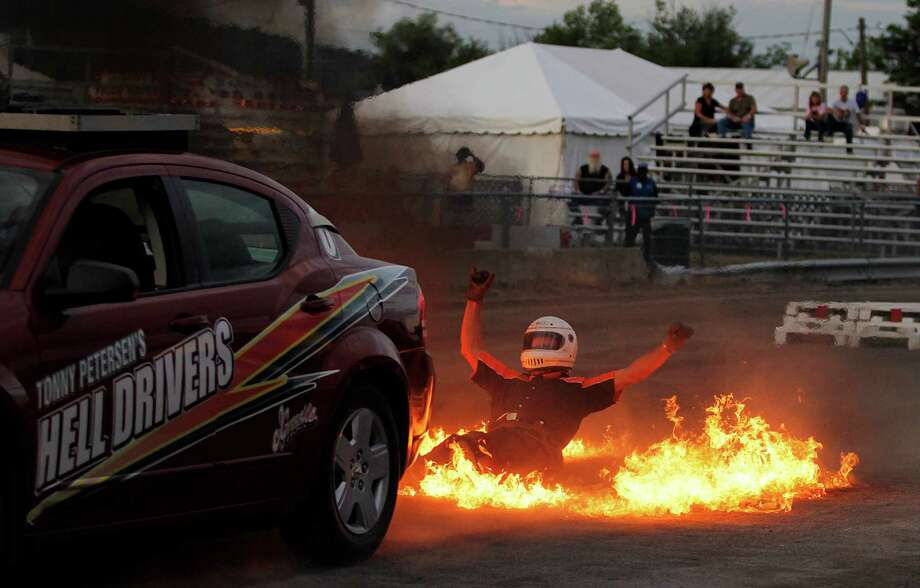 Hell Drivers member Tonny Petersen is dragged behind a stunt vehicle through a ring of fire at the Grandstand event on opening night of the Schoharie County Fair, Friday July 27, 2012 in Cobleskill, N.Y. (Dan Little/ Special to the Times Union) Photo: Dan Little / 00018575A