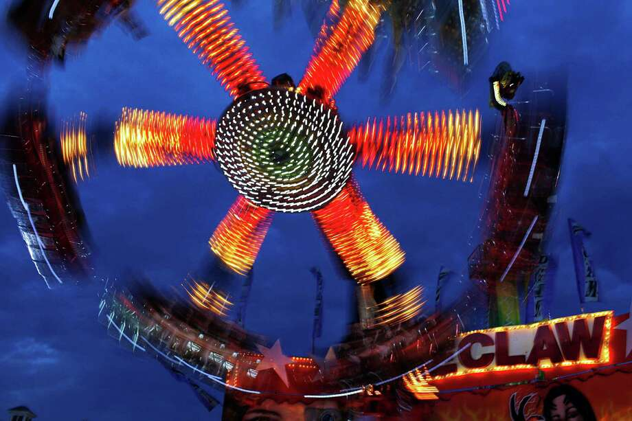 "Schoharie County Fair goers take a spin on ""the Claw"" and get turned upside down at opening night of the fair, Friday July 27, 2012 in Cobleskill, N.Y. (Dan Little/ Special to the Times Union) Photo: Dan Little / Copyright: All Rights Reserved Brett Carlsen"