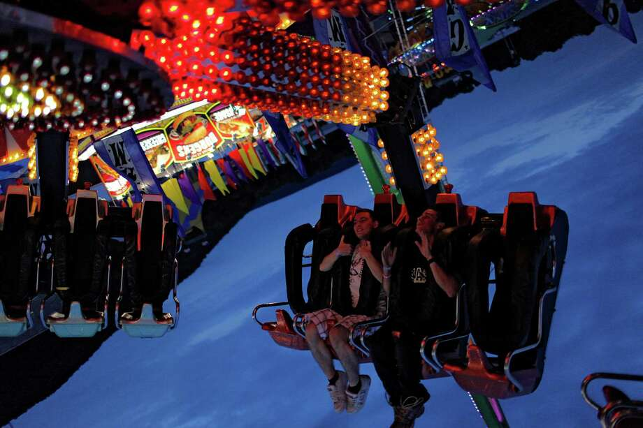 "Schoharie County Fair goers Matt Jaquish and Kennith Marsehilok get turned upside down on ""the Claw"" ride at opening night of the fair, Friday July 27, 2012 in Cobleskill, N.Y. (Dan Little/ Special to the Times Union) Photo: Dan Little / Copyright: All Rights Reserved Brett Carlsen"