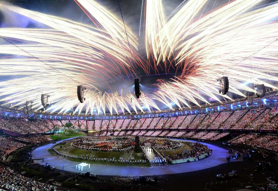 LONDON, ENGLAND - JULY 27:  Fireworks burst above the stadium during the Opening Ceremony of the London 2012 Olympic Games at the Olympic Stadium on July 27, 2012 in London, England.  (Photo by Michael Regan/Getty Images) Photo: Michael Regan