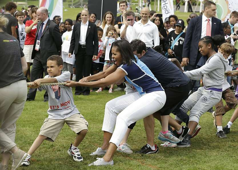 U.S. first lady Michelle Obama plays with schoolchildren during a 'Let's Move!' event for about 1,00