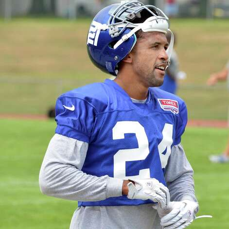 Giants #24, Terrell Thomas takes a breather during training camp session at UAlbany Friday July 27, 2012. Photo: John Carl D'Annibale
