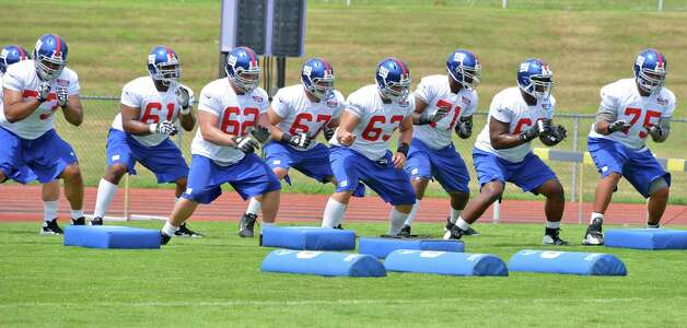 Giants offensive line workout during training camp session at UAlbany Friday July 27, 2012. Photo: John Carl D'Annibale