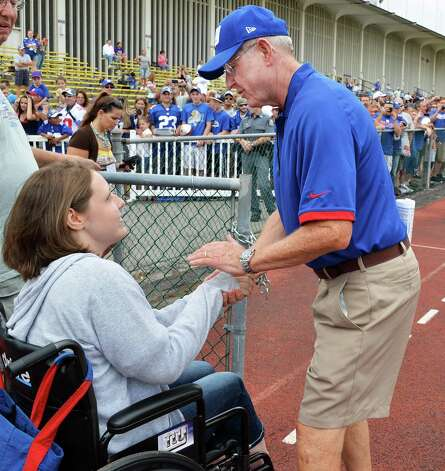 NU Giants head coach Tom Coughlin, at right, stops to visit with dedicated fan Brenda Talbot at the first full day of Giants training camp at UAlbany Friday July 27, 2012.  (John Carl D'Annibale / Times Union) Photo: John Carl D'Annibale