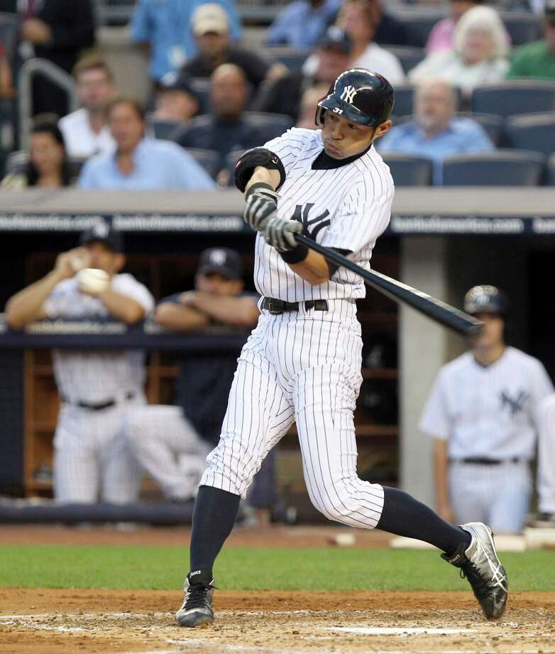 New York Yankees' Ichiro Suzuki flies out in his first at-bat during the second inning of a baseball game against the Boston Red Sox at Yankee Stadium in New York, Friday, July 27, 2012. (AP Photo/Seth Wenig) Photo: Seth Wenig