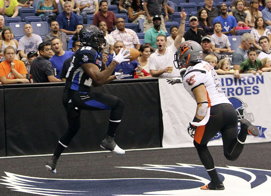 San Antonio Talons' Jomo Wilson (15) reels in a catch for a touchdown against Utah Blaze's David Hyland (09) in the first half of their quarterfinal AFL National Conference playoff game at the Alamodome on Friday, July 27, 2012. Photo: Kin Man Hui, San Antonio Express-News / ©2012 San Antonio Express-News
