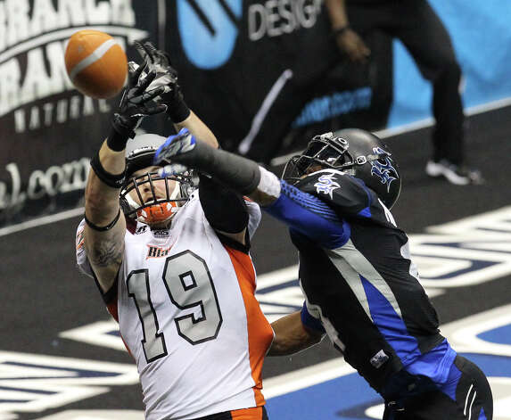 Utah Blaze's Tysson Poots (19) gets a pass deflected from his hands by San Antonio Talons' Kenneth Fontenette (04) in the first half of their quarterfinal AFL National Conference playoff game at the Alamodome on Friday, July 27, 2012. Photo: Kin Man Hui, San Antonio Express-News / ©2012 San Antonio Express-News