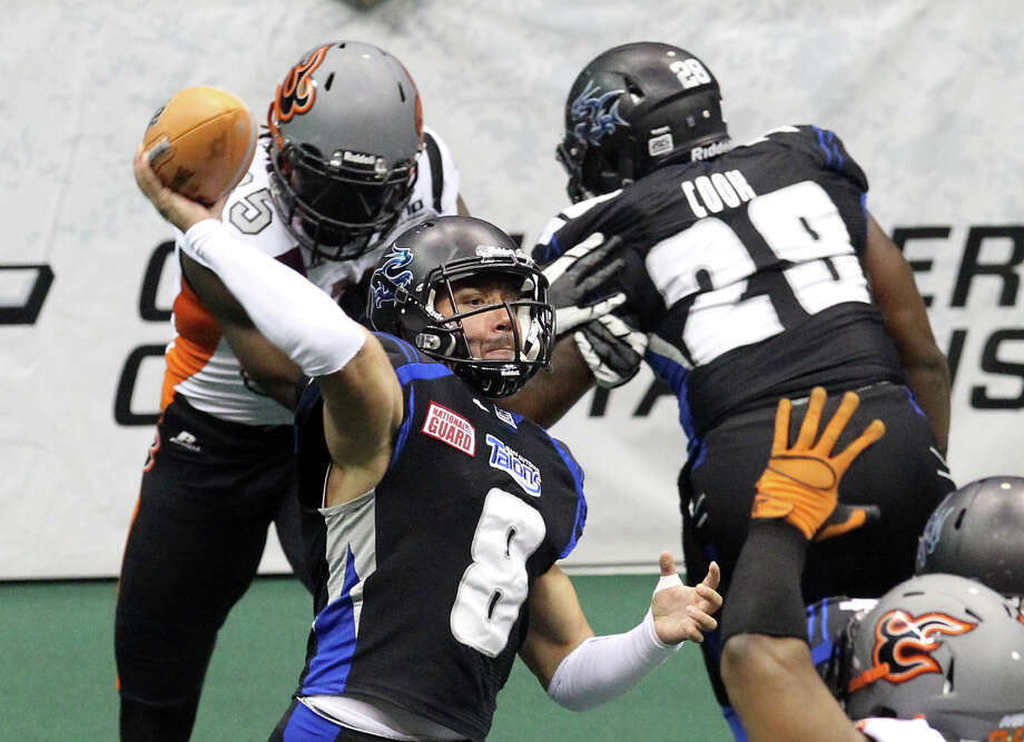 San Antonio Talons' Aaron Garcia (08) drops back for a pass against the Utah Blaze in the first half of their quarterfinal AFL National Conference playoff game at the Alamodome on Friday, July 27, 2012. Photo: Kin Man Hui, San Antonio Express-News / ©2012 San Antonio Express-News