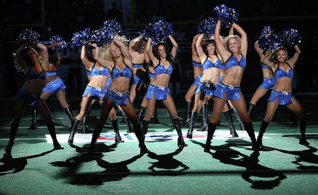 San Antonio Talons' Skydancers perform before the game against the Utah Blaze in the quarterfinal AFL National Conference playoff game at the Alamodome on Friday, July 27, 2012. Photo: Kin Man Hui, San Antonio Express-News / ©2012 San Antonio Express-News