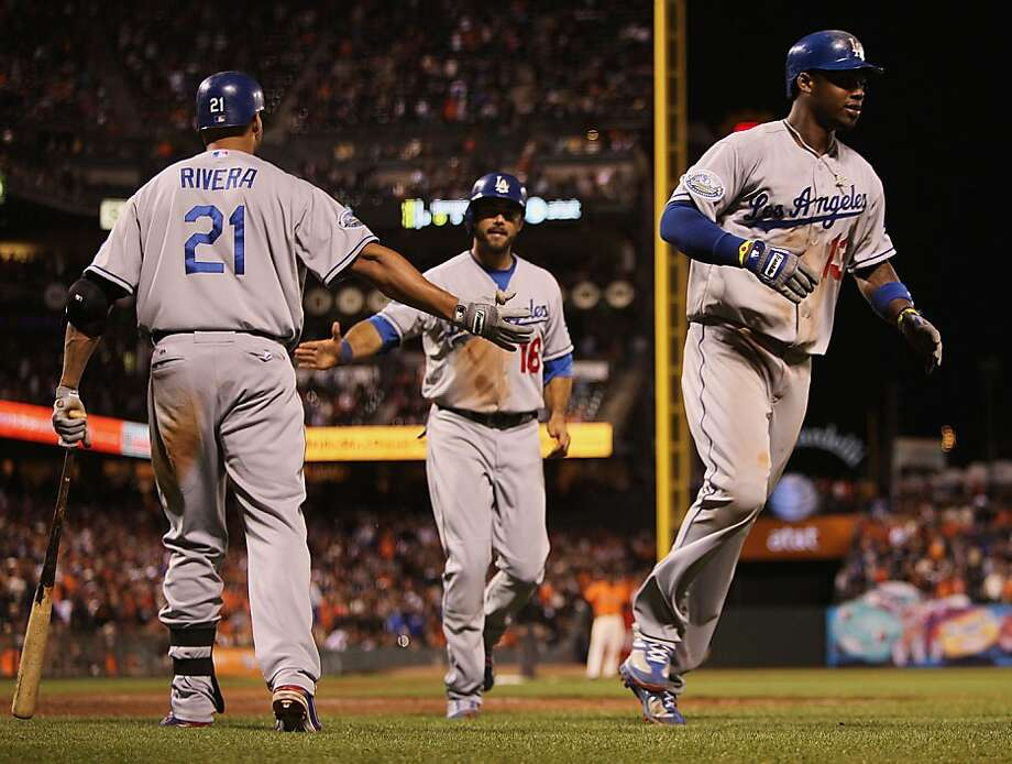 LA Dodgers Hanley Ramirez (right) runs to home base after hitting a home run during the 10th inning at AT&T park in San Francisco, Calif., as the game goes into overtime on Friday, July 27, 2012. Photo: Liz Hafalia, The Chronicle