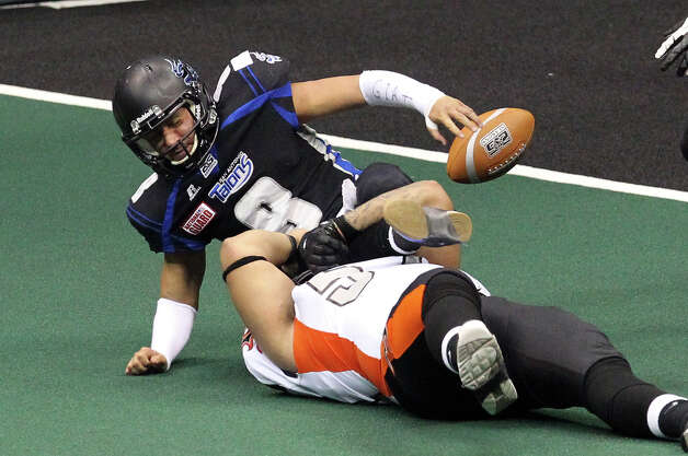 San Antonio Talons' Aaron Garcia (08) gets sacked by Utah Blaze's Keenan Mace (57) in the second half of their quarterfinal AFL National Conference playoff game at the Alamodome on Friday, July 27, 2012. Photo: Kin Man Hui, San Antonio Express-News / ©2012 San Antonio Express-News