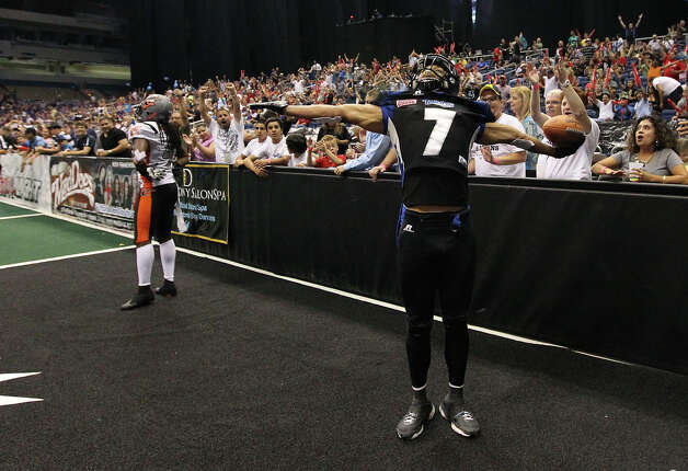 San Antonio Talons' Jason Willis (07) soaks in the moment after scoring a touchdown against the Utah Blaze in the second half of their quarterfinal AFL National Conference playoff game at the Alamodome on Friday, July 27, 2012. Photo: Kin Man Hui, San Antonio Express-News / ©2012 San Antonio Express-News