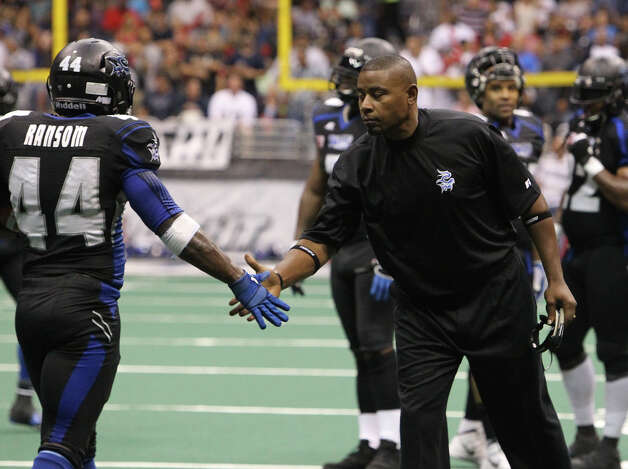San Antonio Talons' coach Lee Johnson praises Jamar Ransom (44) for a head's up play for an interception against the Utah Blaze in the second half of their quarterfinal AFL National Conference playoff game at the Alamodome on Friday, July 27, 2012. Photo: Kin Man Hui, San Antonio Express-News / ©2012 San Antonio Express-News