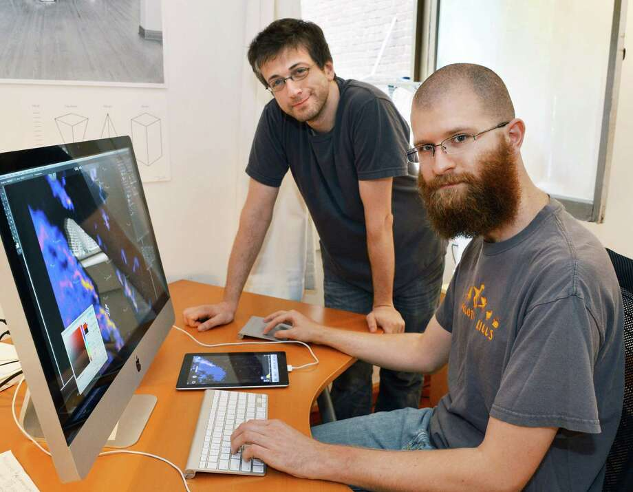 The Dark Sky Company, LLC, managing partners Jack Turner, left, and Jason LaPorte in their Troy offices Thursday July 26, 2012. Photo: John Carl D'Annibale, John Carl D'Annibale / Times Union / 00018606A