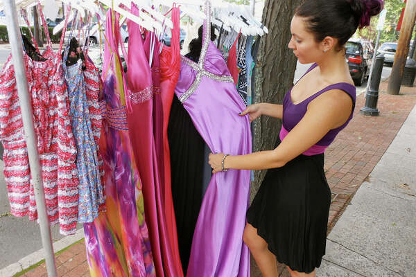 Fairfielder Dina Greenstein considers a summer gown at Giuliana's Boutique on the Post Road during the Fairfield Sidewalk Sales on Friday.