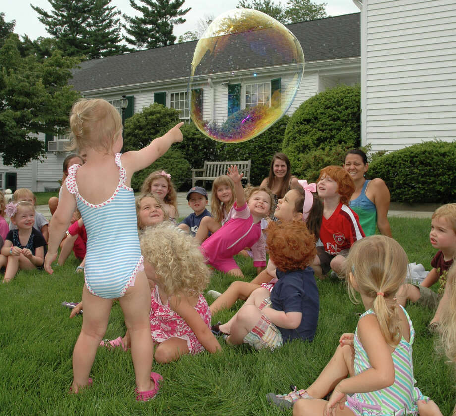 The children at Toddlertime Camp enjoyed a visit from Mr. Bungles Bubble Show, July 26, 2012, New Canaan, Conn. Photo: Contributed Photo