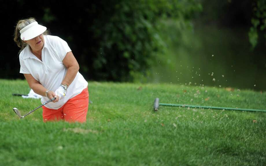 Debbie Vetti hits from the sand trap as she plays in the 2012 Stamford Amateur Golf Championship at E.G. Brennan golf course on Saturday, July 28, 2012. Photo: Lindsay Niegelberg / Stamford Advocate
