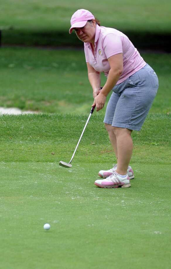 Eileen Russo plays in the 2012 Stamford Amateur Golf Championship at E.G. Brennan golf course on Saturday, July 28, 2012. Photo: Lindsay Niegelberg / Stamford Advocate