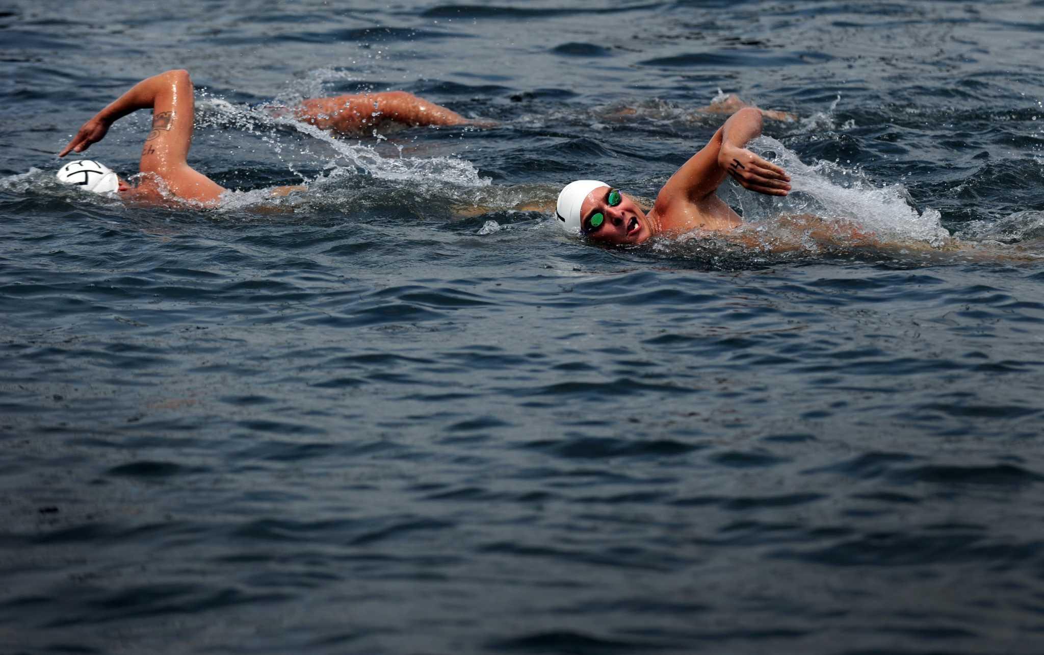 Rain choppy seas force swim to shelter of black rock - Stratford swimming pool opening times ...