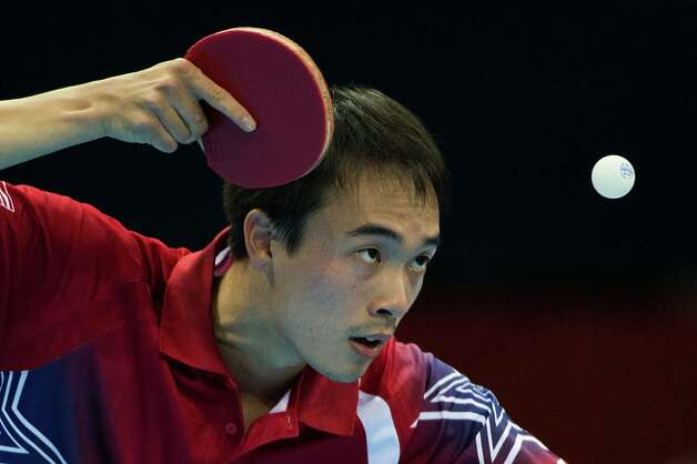 Timothy Wang of Houston serves against Kim Song Nam of the People's Republic of Korea in the men's singles preliminary round of table tennis at the 2012 London Olympics on Saturday, July 28, 2012. Photo: Smiley N. Pool, Houston Chronicle / © 2012  Houston Chronicle
