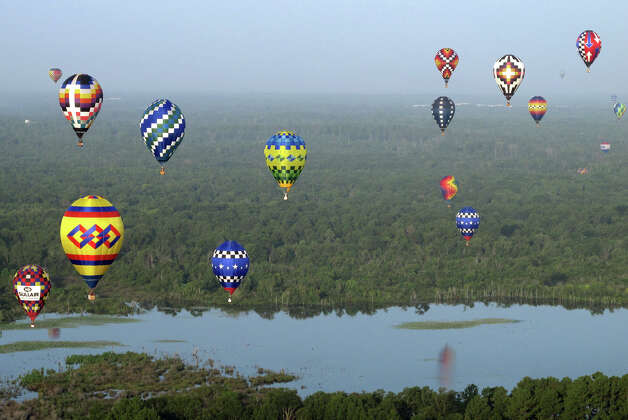 Hot air balloon pilots compete in the Great Texas Balloon Race and U.S. National Hot Air Balloon Championship, on Saturday, July 28, 2012, at the East Texas Regional Airport in Longview, Texas. Photo: AP