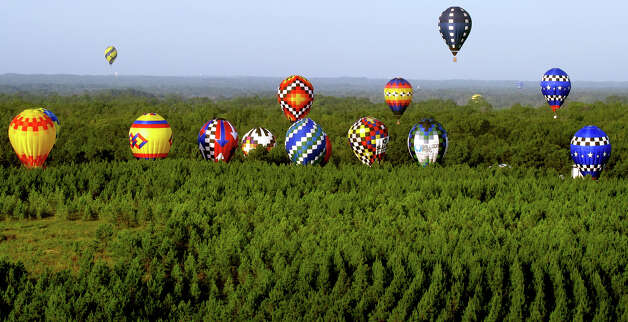 Hot air balloon pilots prepare to land at the Great Texas Balloon Race and U.S. National Hot Air Balloon Championship, on Saturday, July 28, 2012, at the East Texas Regional Airport in Longview, Texas. Photo: AP