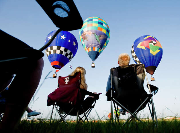 Charlotte and Bryan Beresik watch the Great Texas Balloon Race and U.S. National Hot Air Balloon Championship, on Saturday, July 28, 2012, at the East Texas Regional Airport in Longview, Texas. Photo: AP