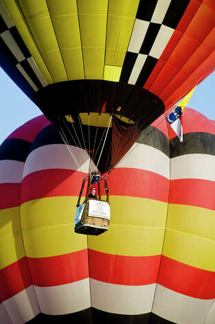 Balloons take flight in the Great Texas Balloon Race and U.S. National Hot Air Balloon Championship, on Saturday, July 28, 2012, at the East Texas Regional Airport in Longview, Texas. Photo: AP