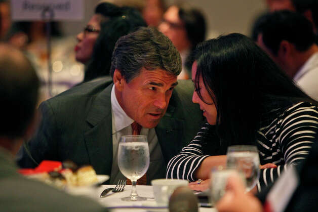 Governor Rick Perry talks with Jennifer Korn, Executive Director of the Hispanic Leadership Network,  before speaking at the Hispanic Leadership Network's Small Business Invitational at the Marriott Rivercenter Hotel in San Antonio on Saturday, July 28, 2012. Photo: Lisa Krantz, San Antonio Express-News / San Antonio Express-News