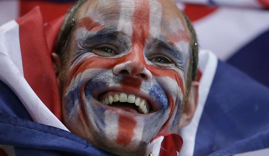 A supporter of Great Britain celebrates his team prior to the women's handball preliminary match between Montenegro and Great Britain at the 2012 Summer Olympics, Saturday, July 28, 2012, in London. (AP Photo/Matthias Schrader) Photo: Matthias Schrader, Associated Press