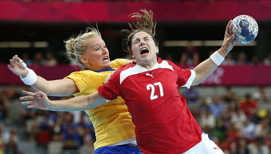 Denmark's Louise Burgaard, right, is challenged by Sweden's Kristina Flognman, left, during their women's handball preliminary match at the 2012 Summer Olympics, Saturday, July 28, 2012, in London. (AP Photo/Vadim Ghirda) Photo: Vadim Ghirda, Associated Press